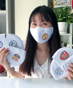 girl with alot of facemasks with football club logo