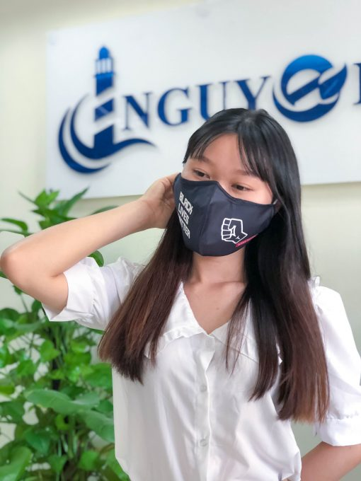 girl wears facemask with text and icon