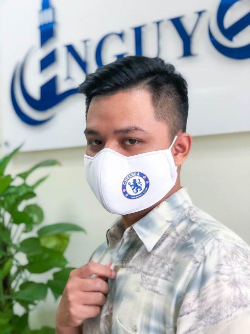 boy wear facemask with Chelsea football club logo